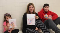 students with books, drawings and sewn monsters 8