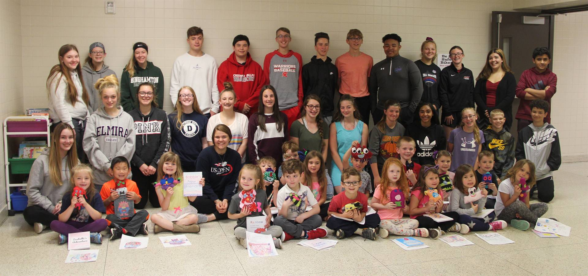 high school, middle school and kindergarten students in hallway with monster creations 2