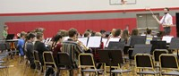 high school band students performing