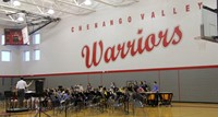 wide shot of middle school band students performing