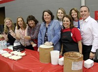 chenango valley staff members helping with ice cream social