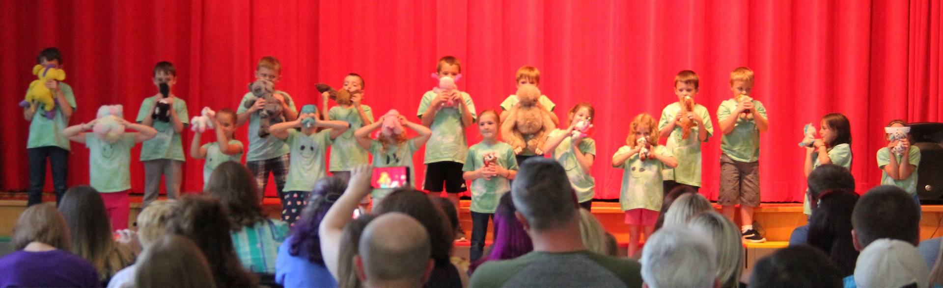 students singing in first grade show 10