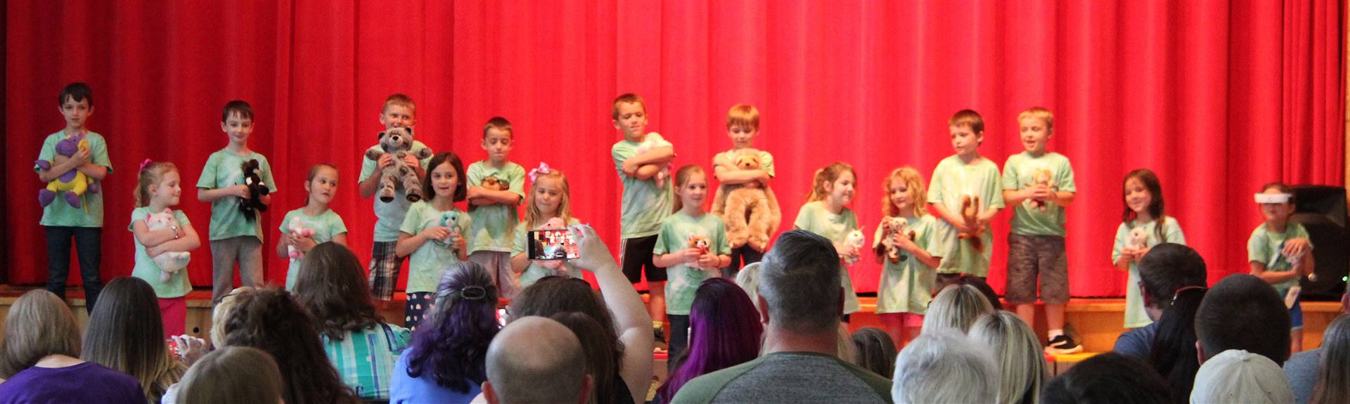 students singing in first grade show 9
