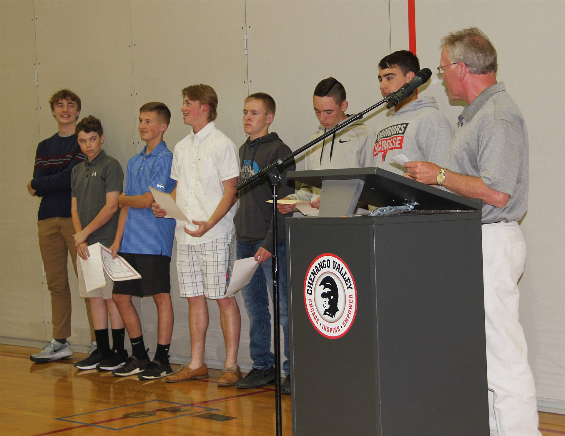 boys golf team members and coach