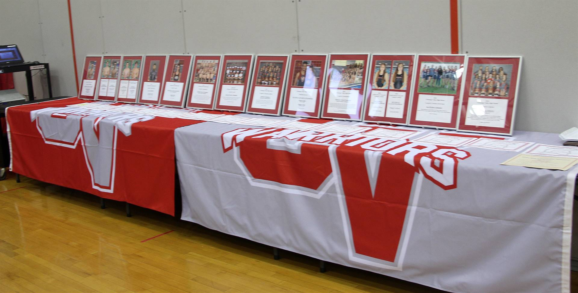 wide shot of athletes award plaques