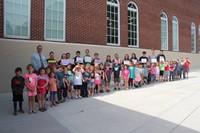 kindergarten and high school students outdoors