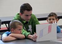 high school student reading to kindergarten students 22