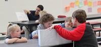 high school students reading to kindergarten students 18