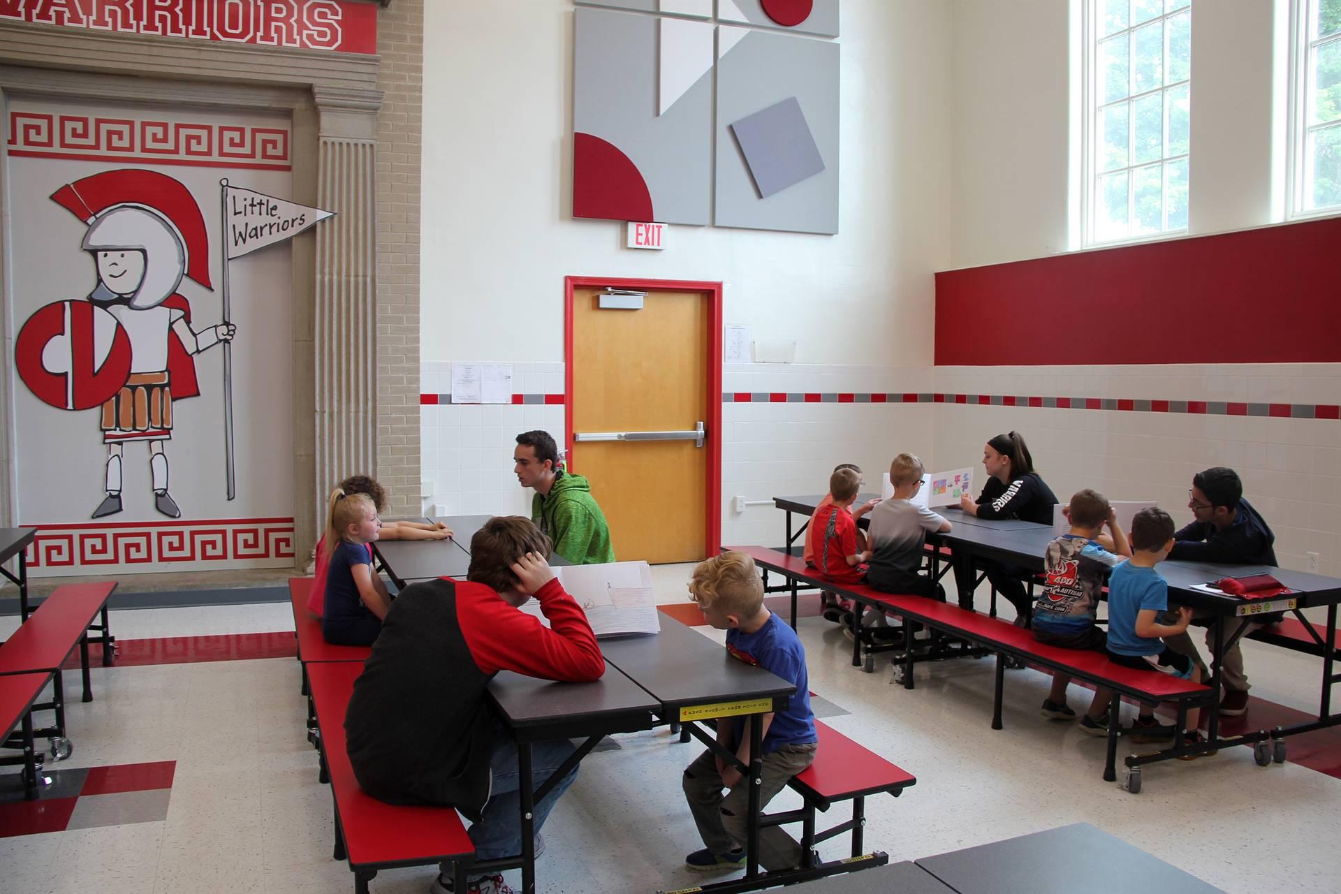 high school students reading to kindergarten students 14