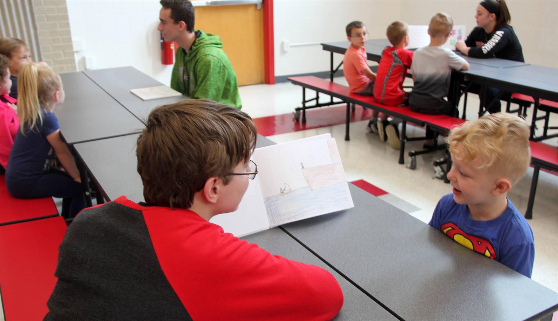 high school students reading to kindergarten students 13