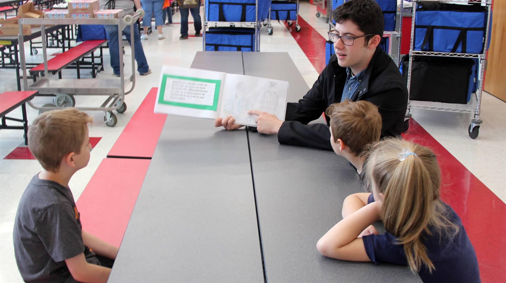 high school student reading to kindergarten students 8