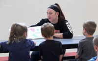 high school student reading to kindergarten students 20