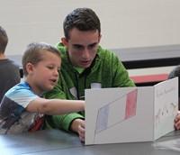 high school student reading to kindergarten students 19