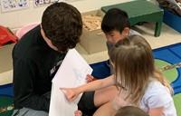 kindergarten student reading story aloud