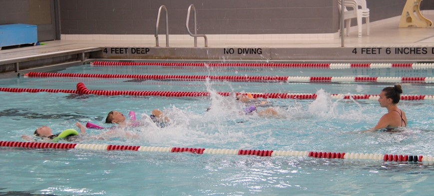 students participating in summer swim lessons