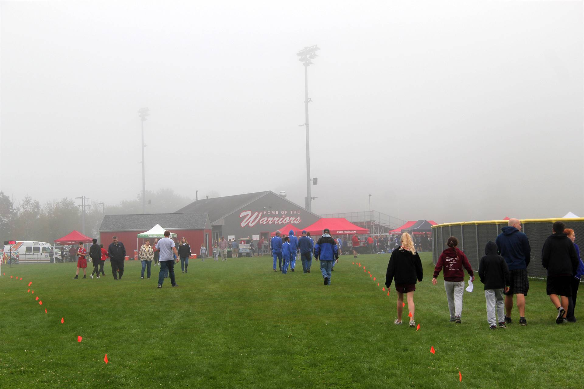 wide shot of people at cross country race