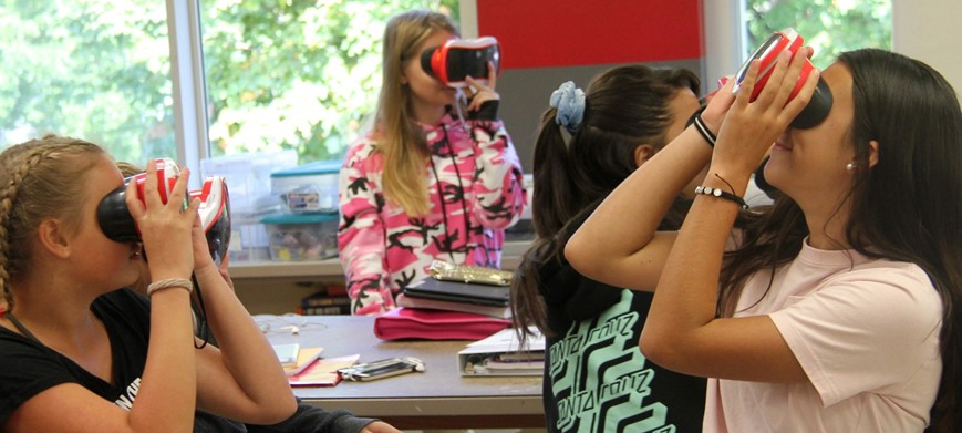 high school students participating in a virtual reality art class