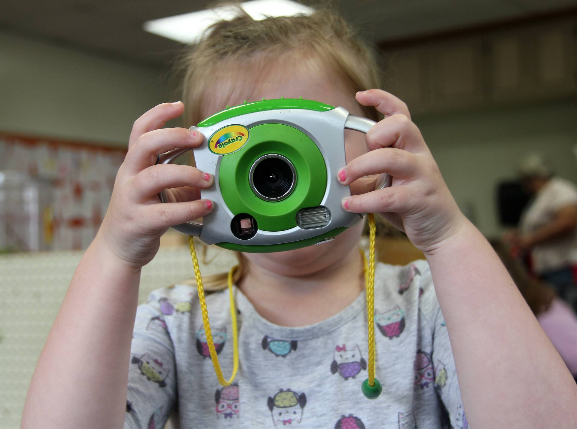 student with play camera