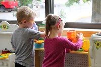students in play kitchen