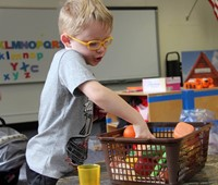 student playing with play food