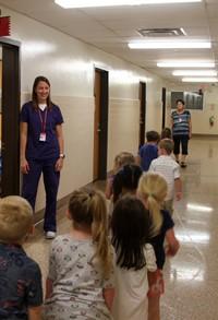 students meeting school nurse