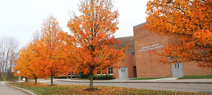 district building with fall foliage in front