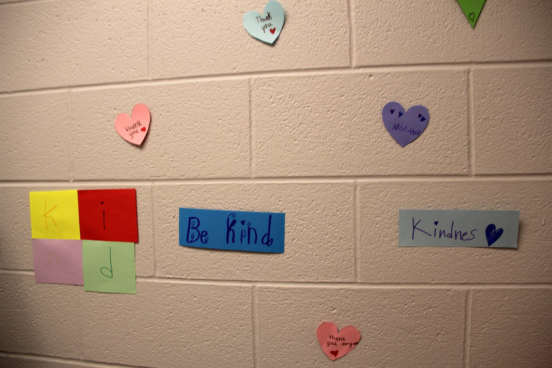 kind posters on wall