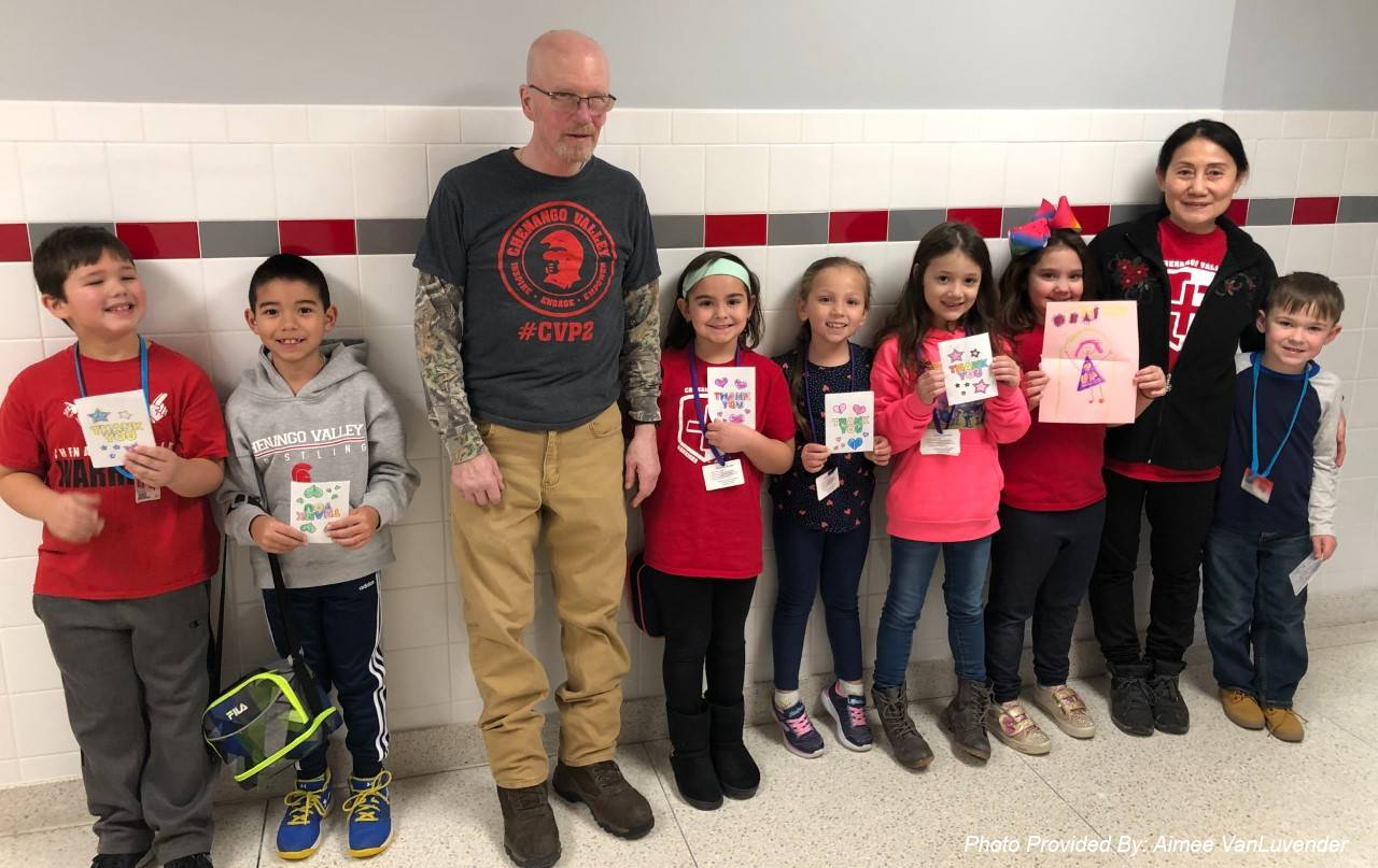 port dickinson elementary students giving thank you cards to facilities staff