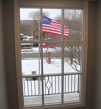 American flag through window