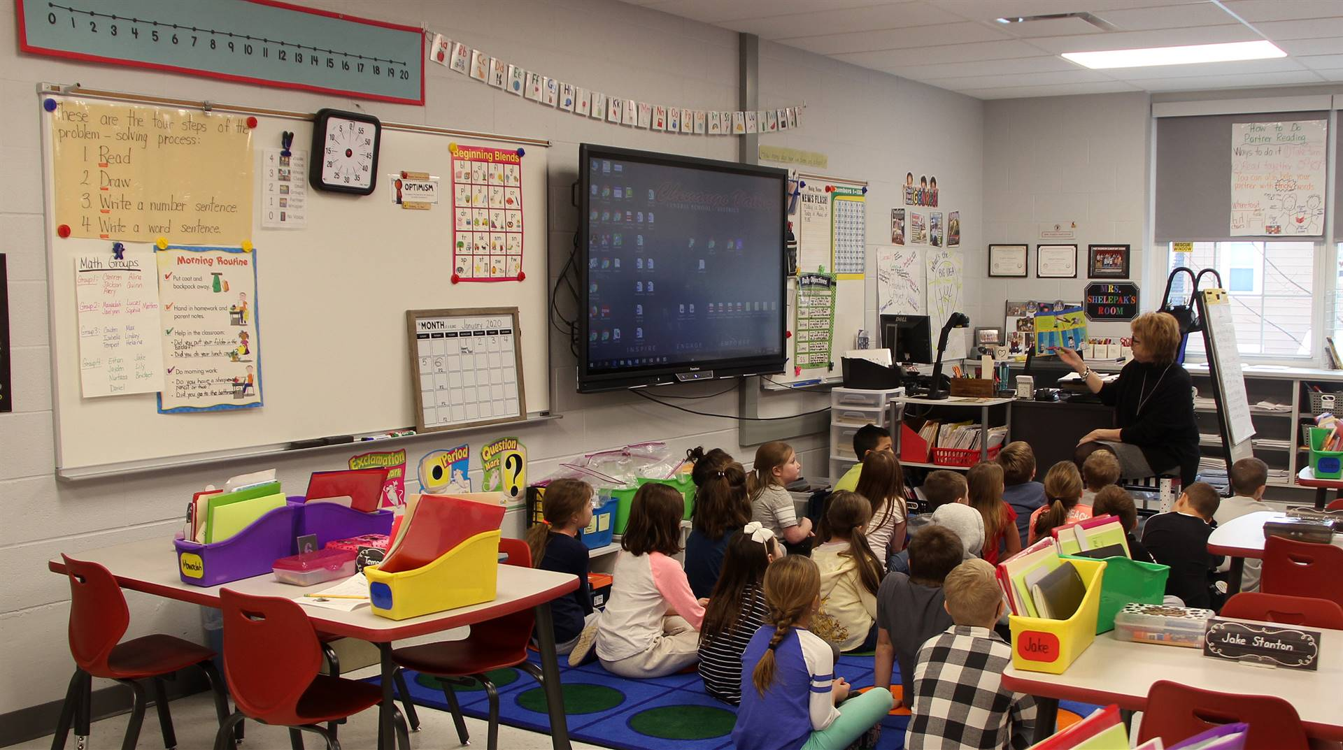 teacher reading to students in classroom