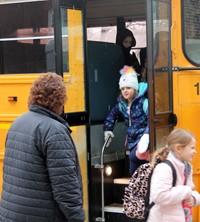 principal greeting students