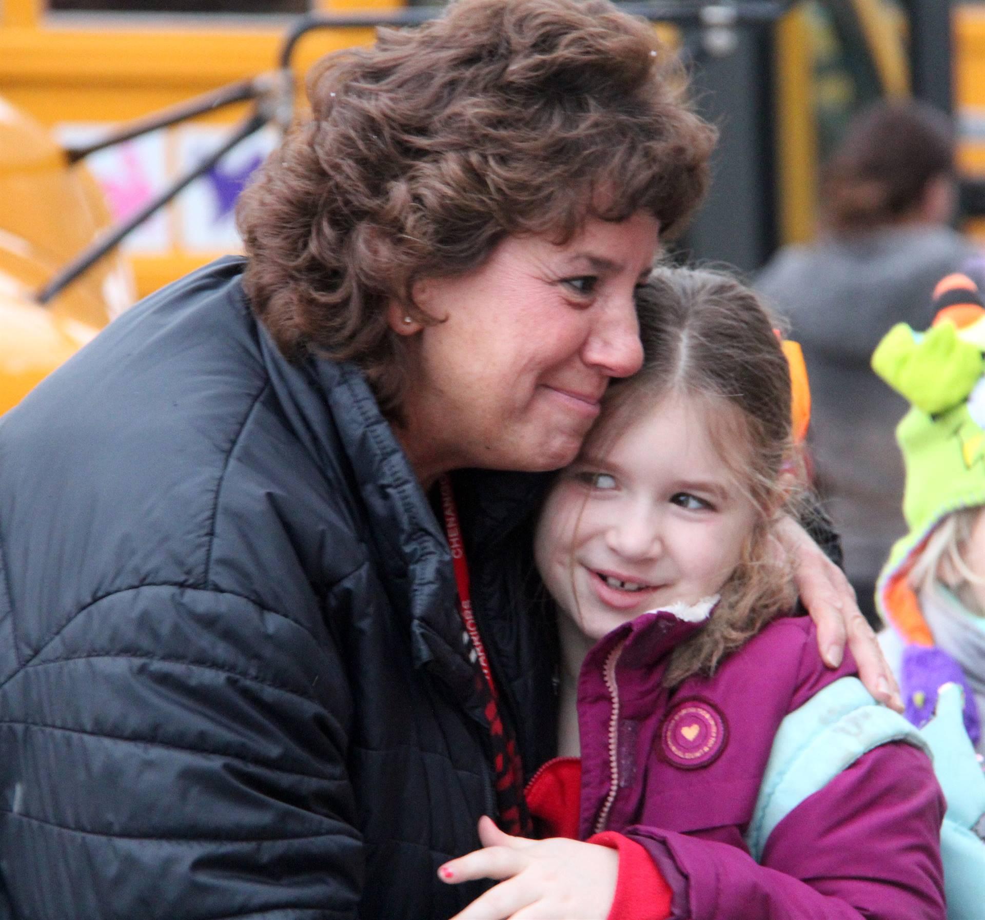 principal hugging student