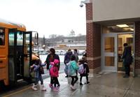 students walking towards school