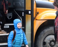 student getting off school bus