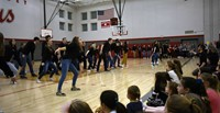 wide shot of high school musical students performing
