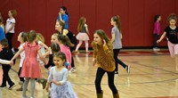 students dancing at big gifted give event