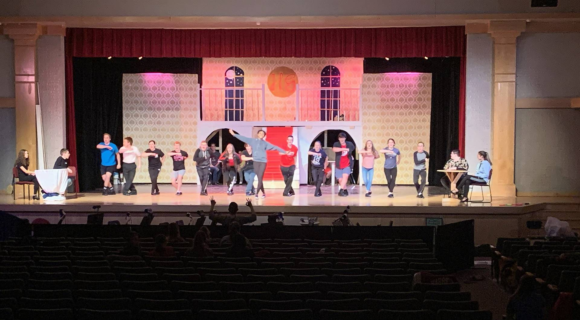 wide shot of students rehearsing