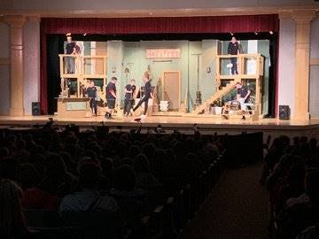 cast members on stage for sneak preview snippet at high school