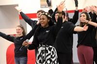 closer shot of high school students singing