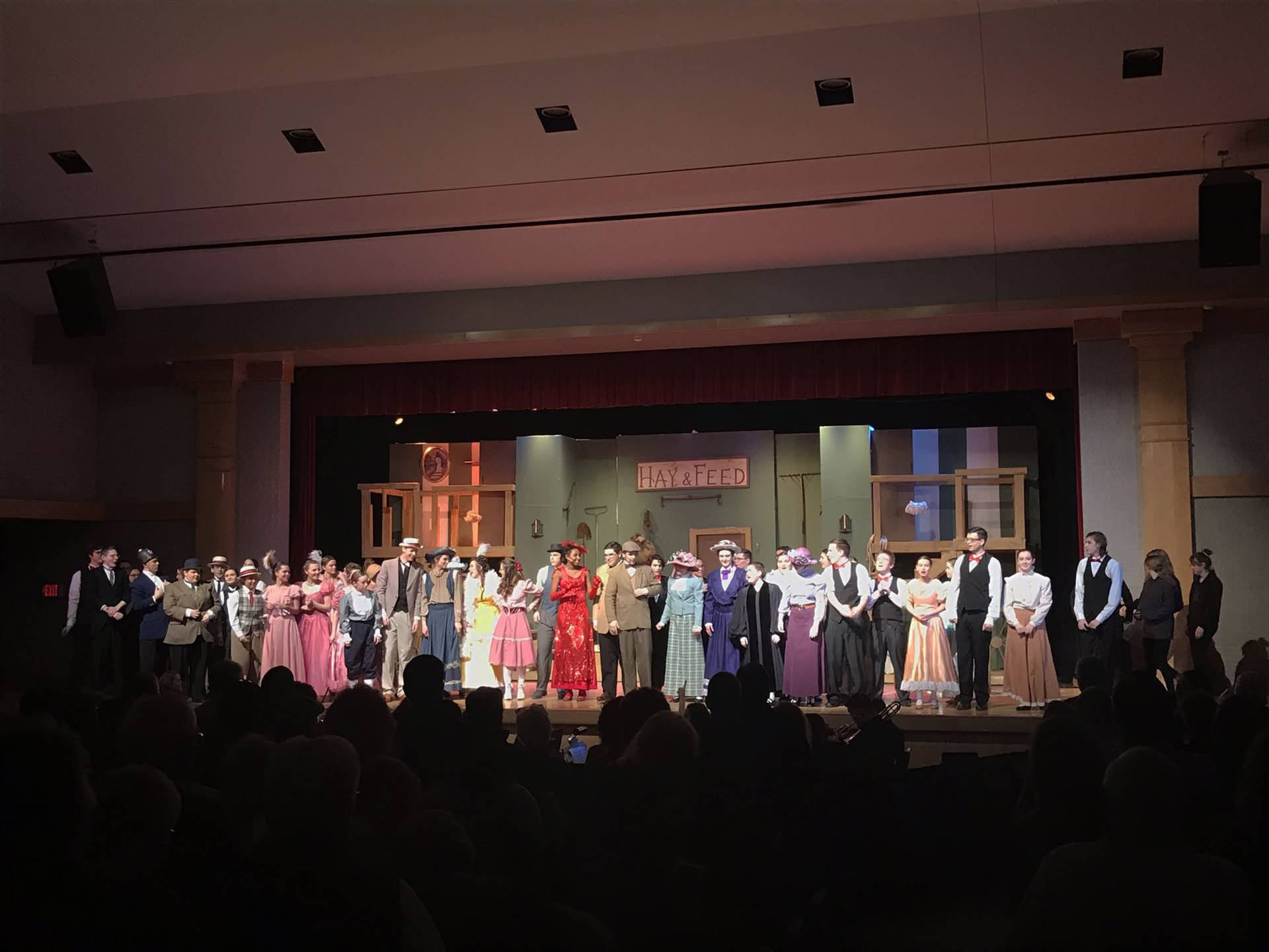 high school theatre guild cast and crew on stage