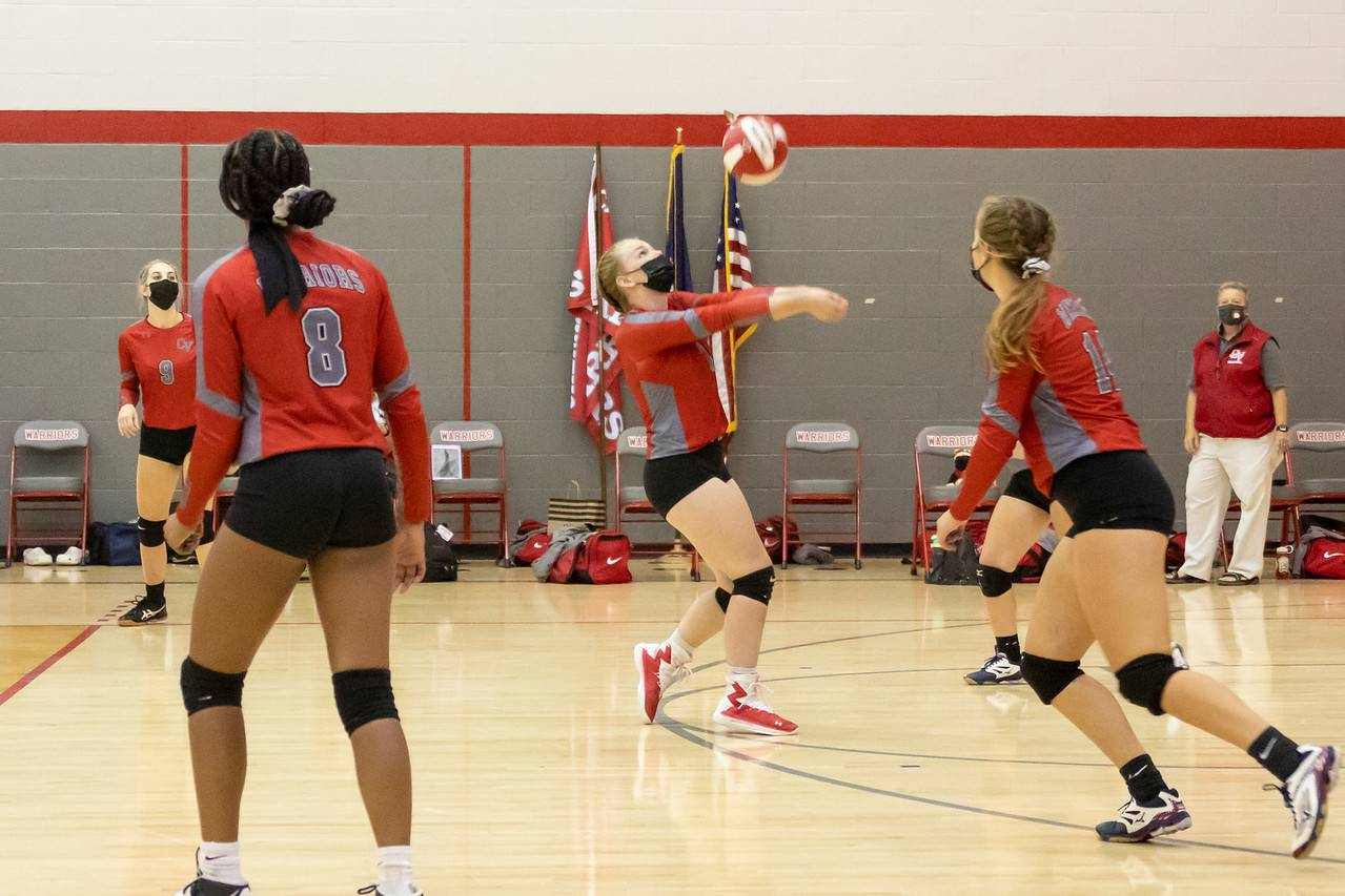 student hitting volleyball