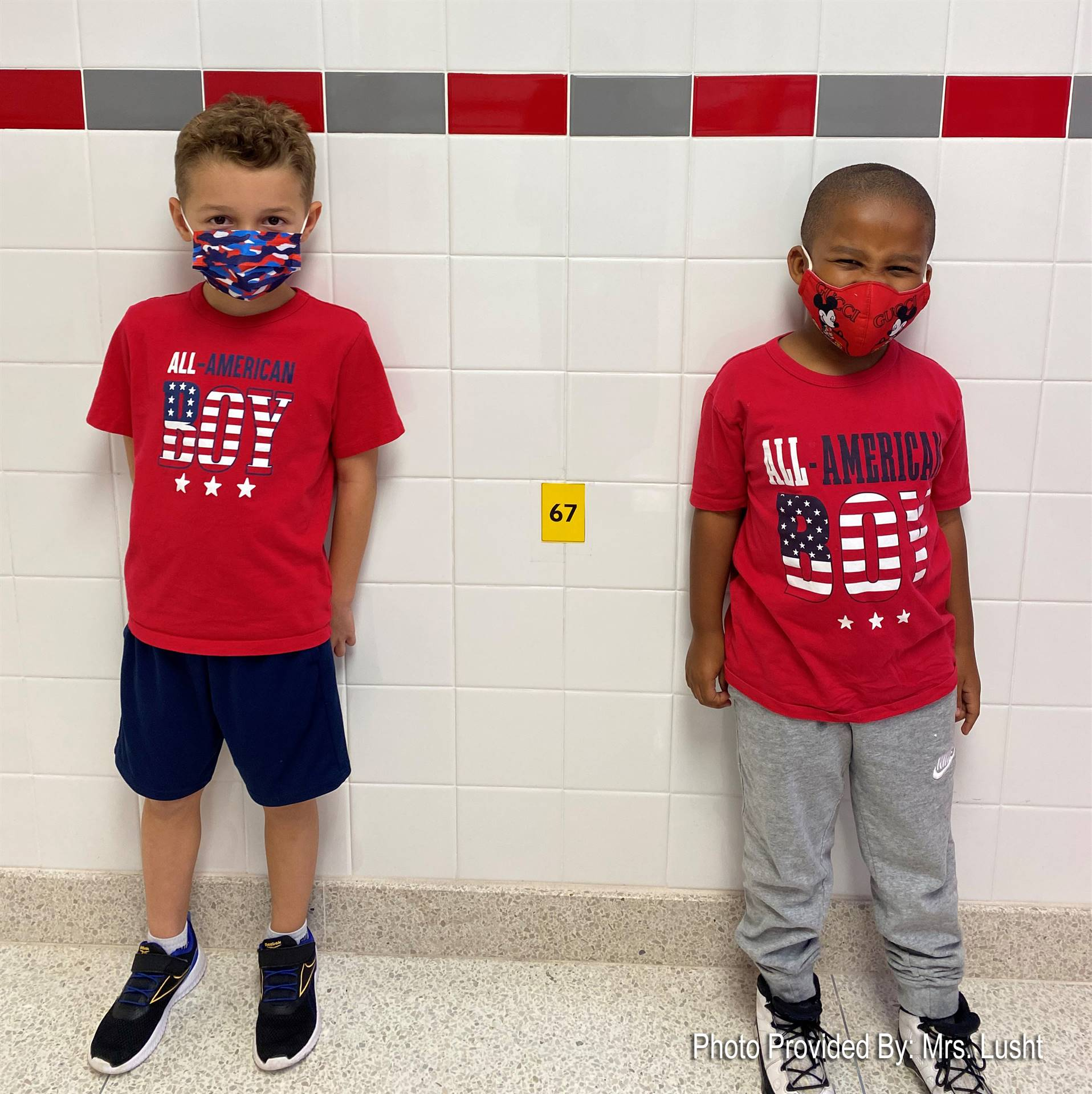 two elementary students dressed in red, white and blue for America Day