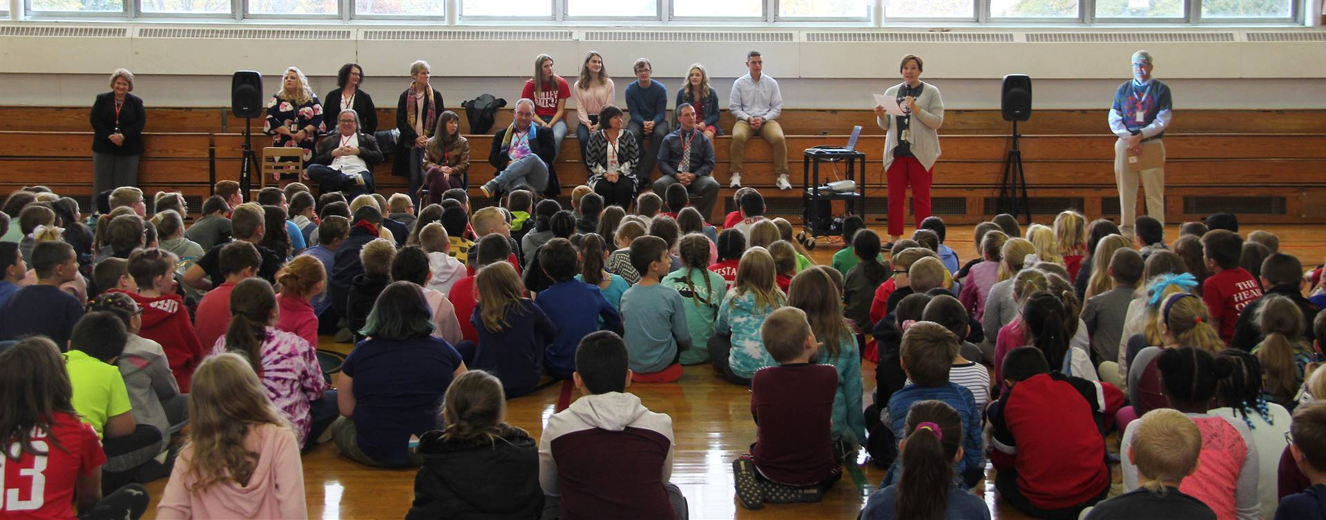 people in gymnasium for presentation