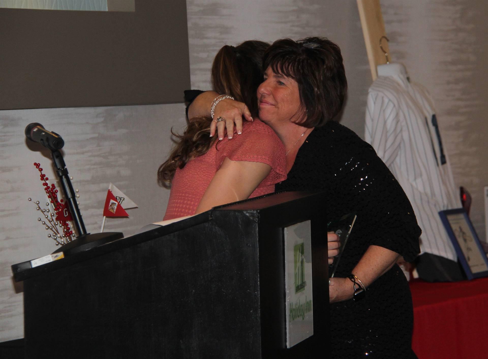 honoree hugging student