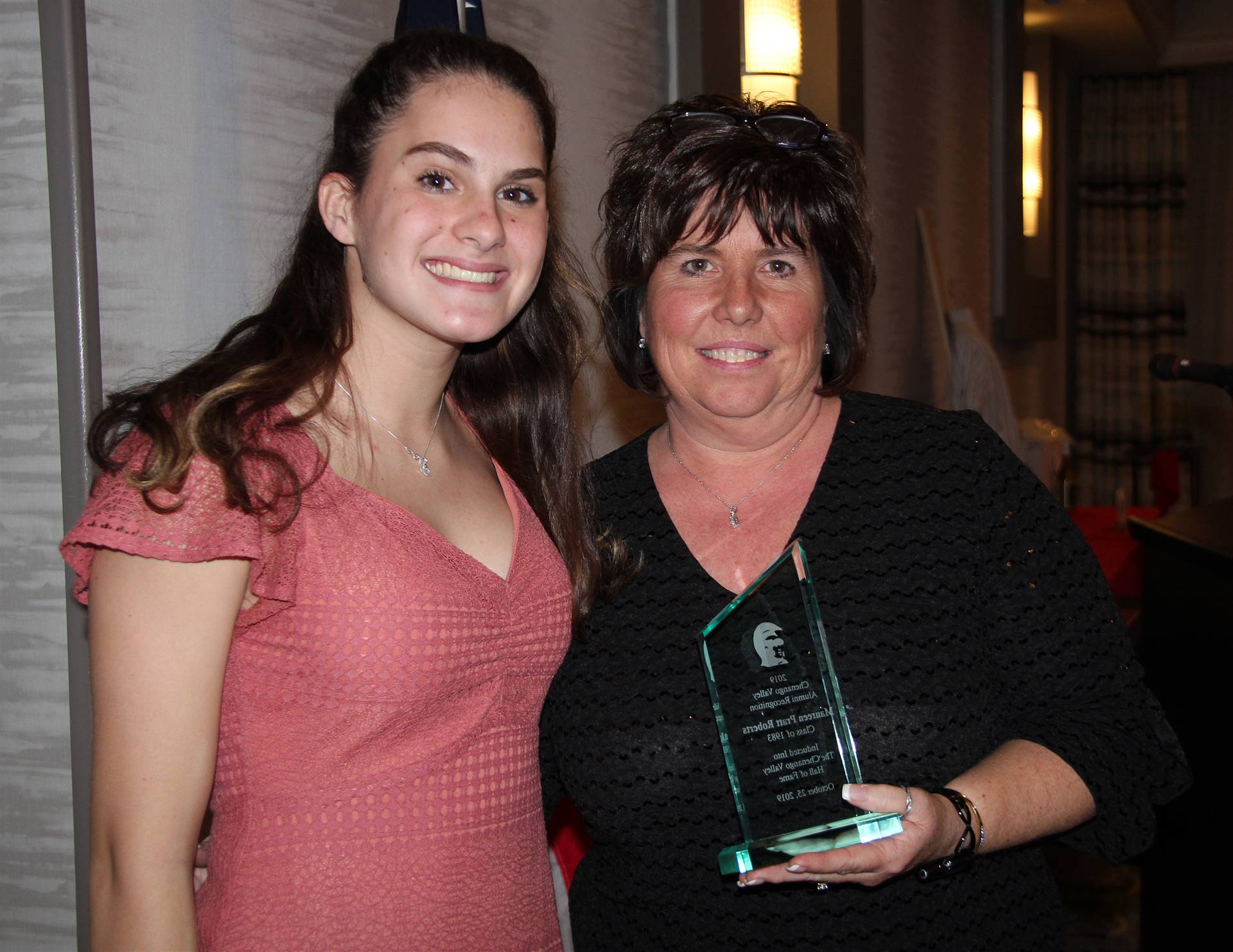 student and honoree at recognition dinner