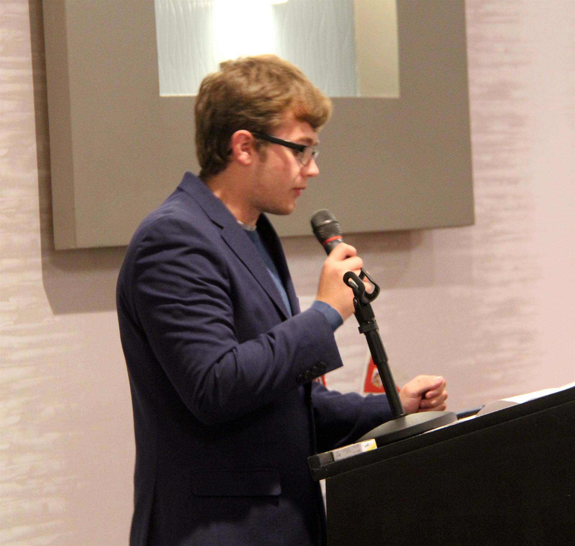 student speaking at recognition dinner